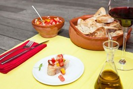 Spanish themed place setting with bread and salsa
